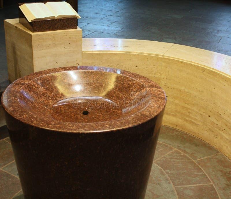 Baptistery and Bible. A baptistery and bible in a Catholic church royalty free stock image