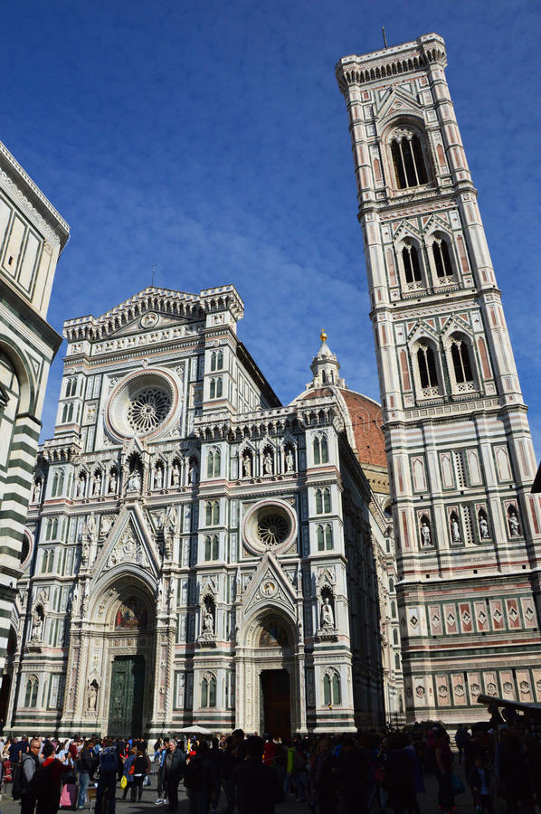 Baptistery of San Giovanni and the Basilica di Santa Maria del Fiore with Giotto campanile tower bell and Brunelleschi dome. Florence, Italy: Baptistery of San royalty free stock photography