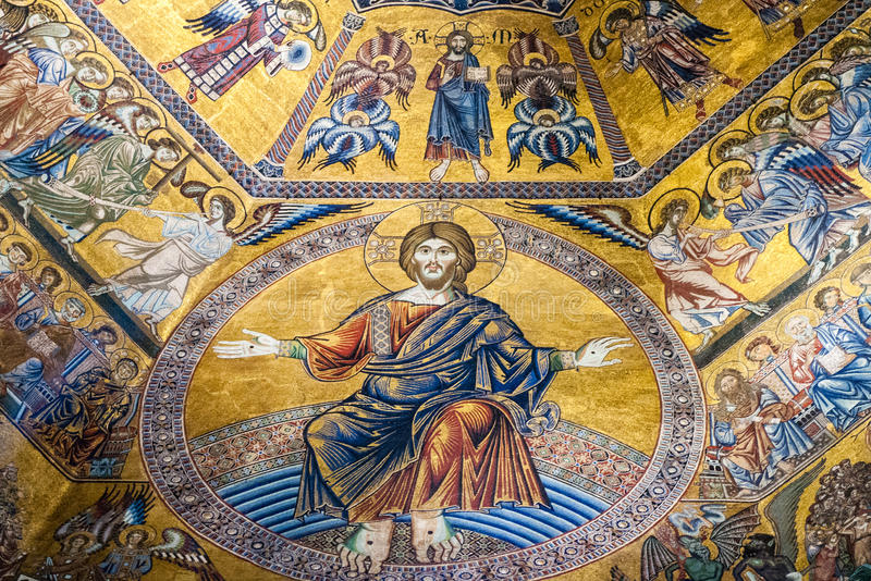 Baptistery of San Giovanni Battistero. Mosaics ceiling of the Last Judgement dominated by a majestic Jesus Christ. At Christ's right hand there are the royalty free stock photos