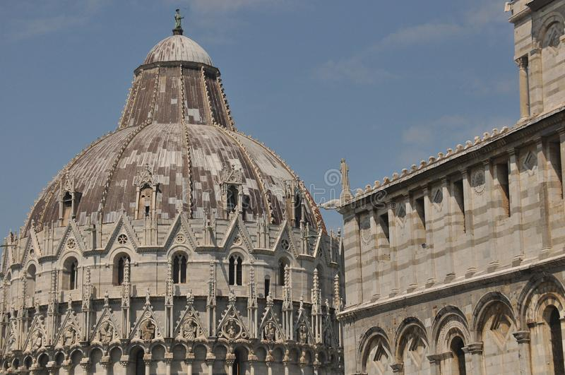 Baptistery of San Giovanni in Pisa. Historic building along the tower curve.  stock photo