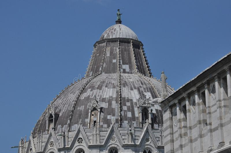 Baptistery of San Giovanni in Pisa. Historic building along the tower curve.  stock photography