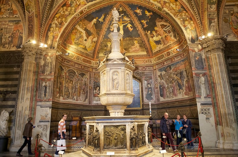 Baptistery of San Giovanni, Siena, Tuscany, Italy. The baptismal font at the Baptistery of San Giovanni, Siena, Tuscany, Italy. The Baptistery of San Giovanni stock image