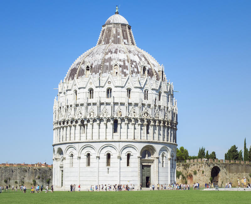 Baptistery of St John in the Square of Miracles, Pisa Italy. View of the grand Roman Catholic ecclesiastical building Baptistery of St John in the Square of royalty free stock image