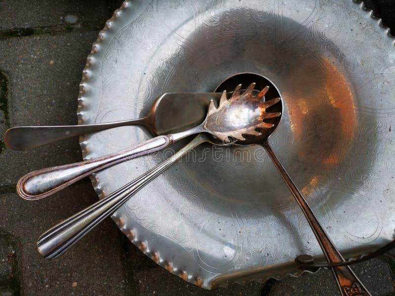 Barłogi i kopyść od srebra wśrodku pucharu zdjęcie stock