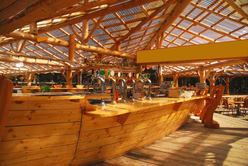 Bar. Wooden Bar, variety of potable spirits stock images
