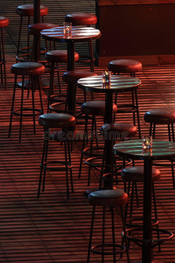 Bar. Chairs and tables in an empty bar royalty free stock photo