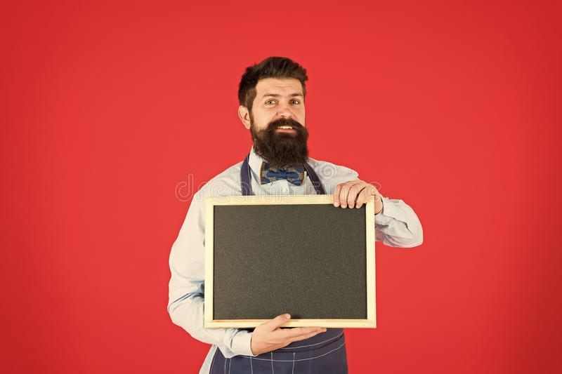 Bar advertisement. Hipster bartender show blackboard copy space. Hipster restaurant staff. Hipster informing you. Man royalty free stock image
