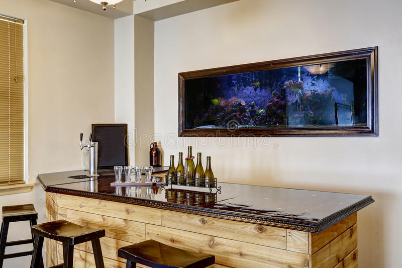 Bar with aquarium. Luxury home interior stock photography