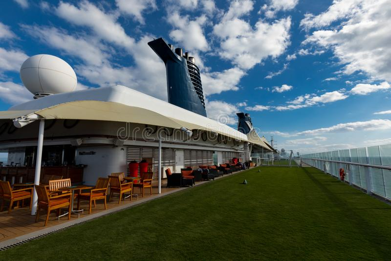 Bar Area and Real Grass Aboard Celebrity Eclipse Cruise stock photo