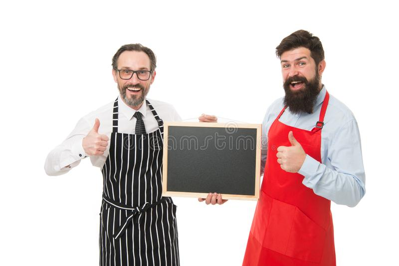 Bar cafe staff. Hiring staff. Men bearded hipster informing you. Men bearded bartender or cook in apron hold blank royalty free stock images