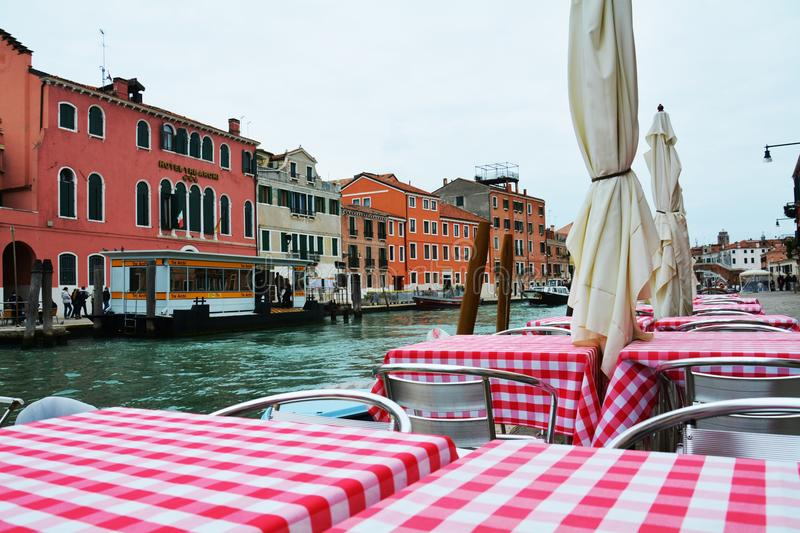 Bar and in canal, in Venice, Italy royalty free stock photo