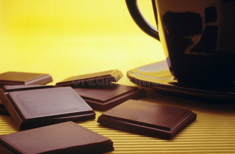 Bar of chocolate and hot chocolate royalty free stock photos