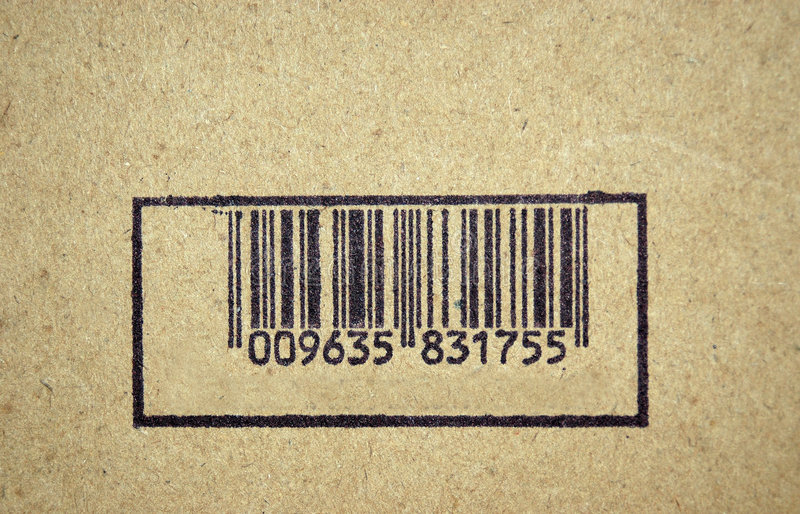 Bar Code. A horizontal bar code stamp with vertical black lines on a label on a page of a book royalty free stock photography