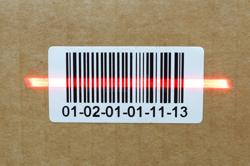 Bar code with laser on carton box stock photos