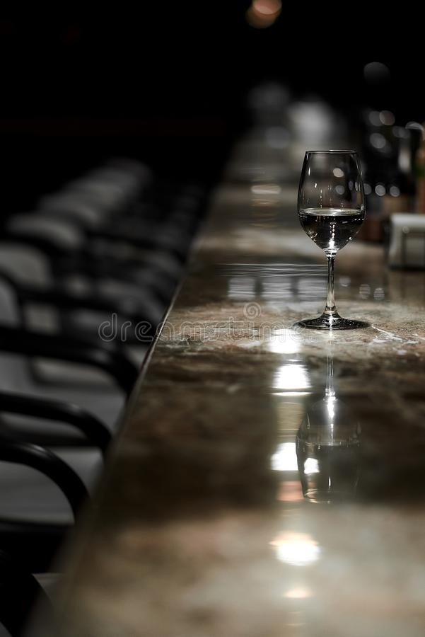 Bar counter, chairs, glass of wine stock image