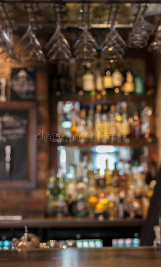Bar counter in English pub with bokeh lights and blurry background. stock photography