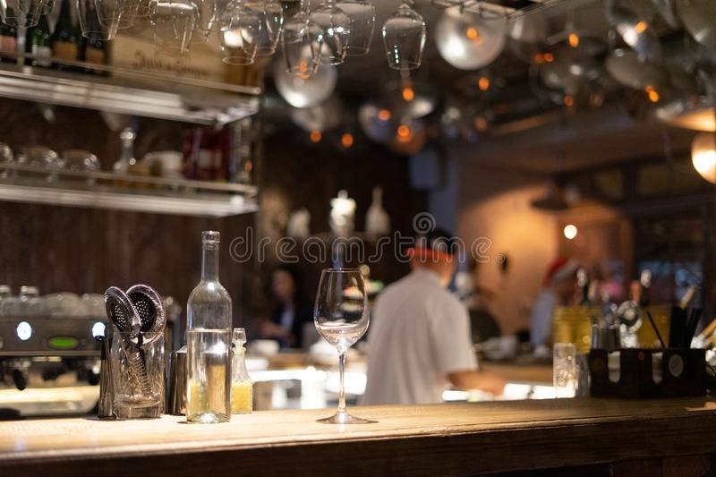 Bar counter with wine glasses stock photography
