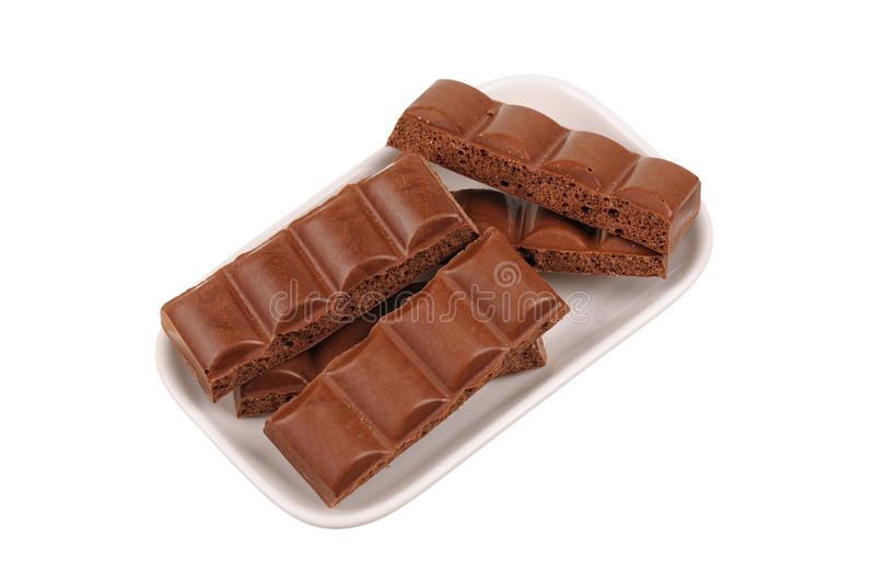 Bar de chocolat criqué dans un paraboloïde sur le blanc image libre de droits