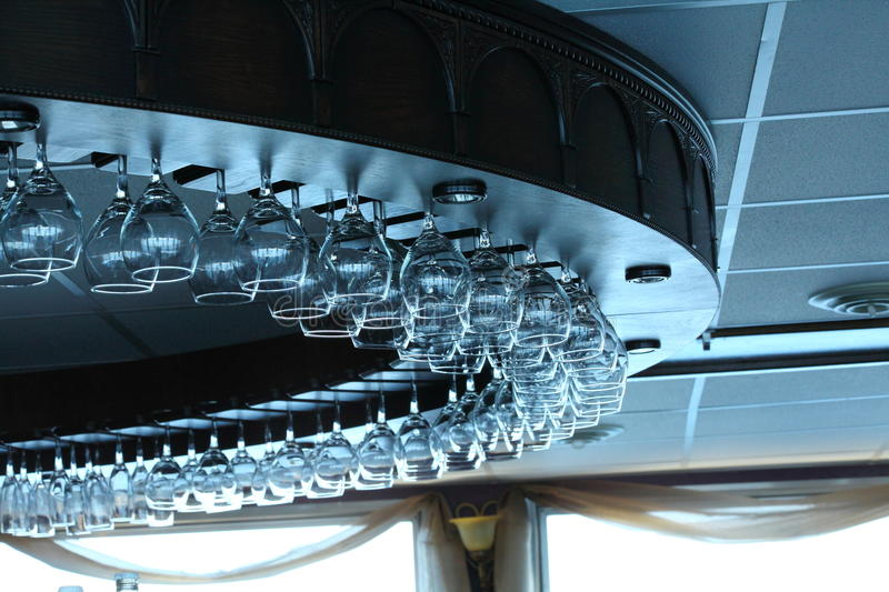 Bar Glass Holder. Glass holder with glass hanging from the ceiling stock images