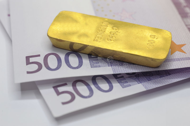 Bar of gold and 1000 Euros. Bar of gold with 1000 euros royalty free stock photography
