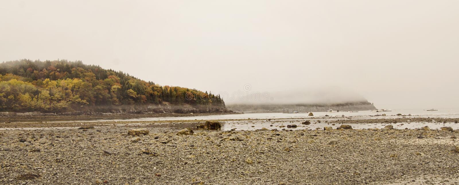 Bar Island in Bar Harbor, Maine. The natural land bridge sand bar at low tide that connects Bar Harbor, Maine and Bar Island in Acadia National Park at Autumn stock image