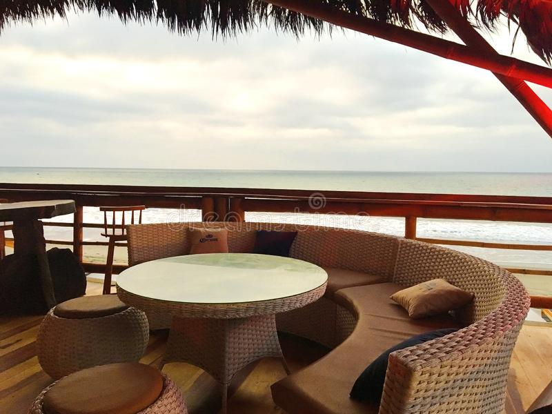 Bar Lounge Area overlooking the Ocean. Circular lounge furniture and table in a Ecuablue, a bar built of bamboo overlooking the Pacific Ocean in Ecuador. The royalty free stock photography