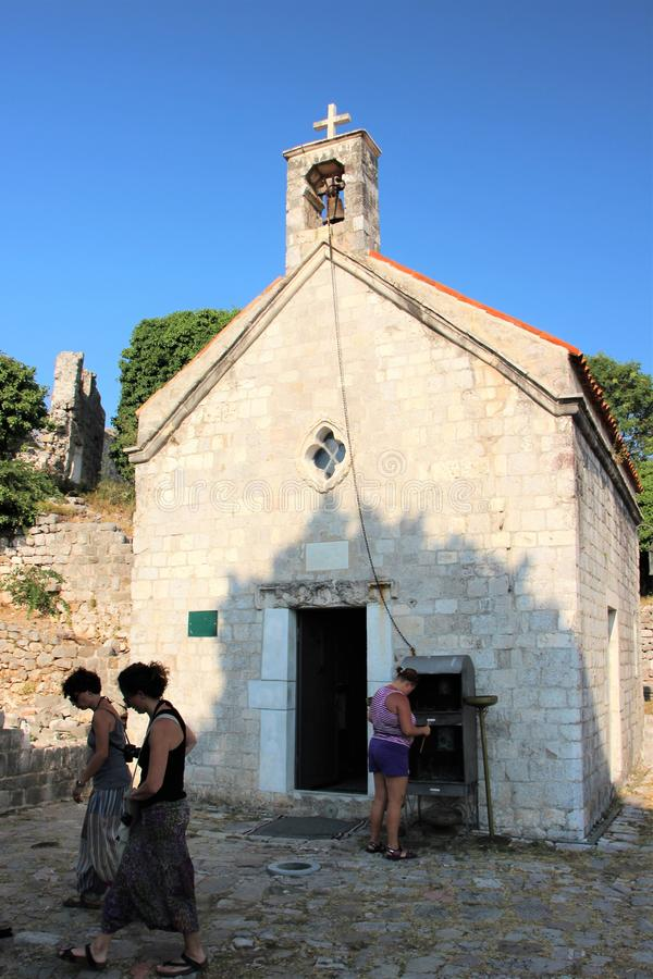 Bar, Montenegro, August 2013. Pilgrims at the entrance to the Orthodox church, built in the fourteenth century. stock images