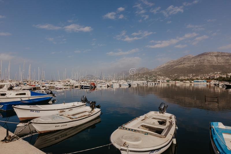 Bar, Montenegro - November 31, 2018. fishing boats on the background of mountains and yachts on the Adriatic coast. - Image stock photos
