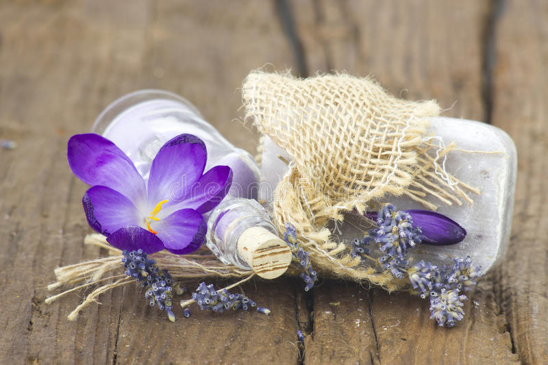 Bar of natural soap, bath salt, dried lavender and crocus royalty free stock photography