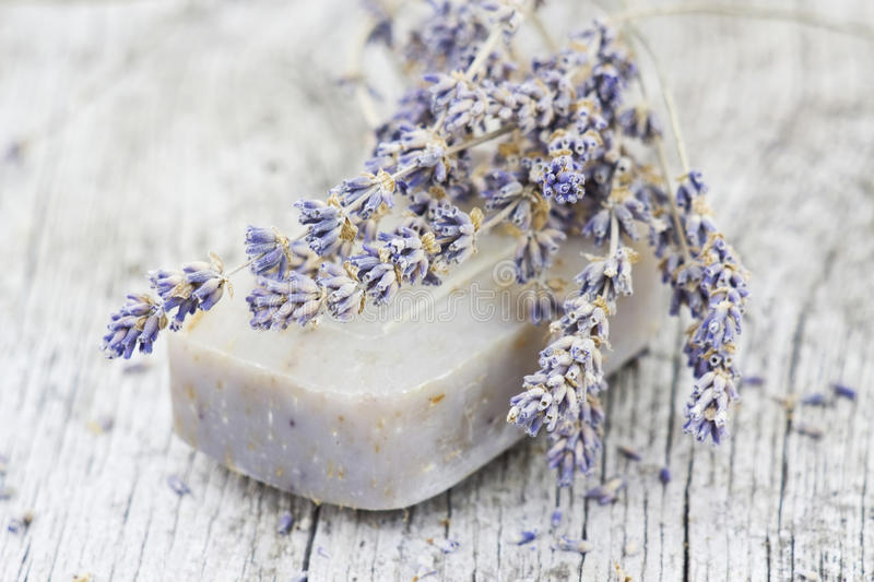Bar of natural soap with dried lavender stock photos