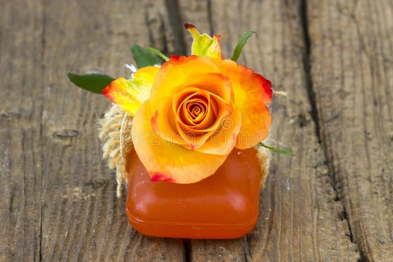 Bar of natural soap and rose stock photo