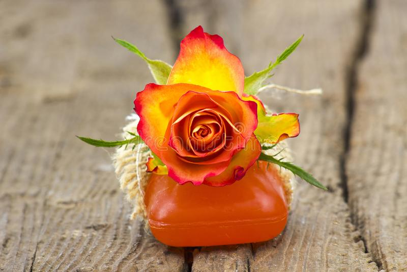 Bar of natural soap and rose royalty free stock photography
