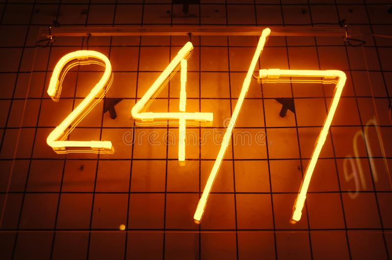 24 7 bar neon red signboard. Open sign. Day and night working. 24 hour concept.  royalty free stock photos