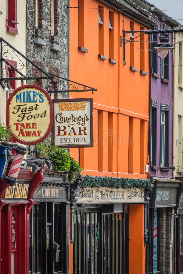 Bar and pubs signs. Pubs, bars and restaurant signs in a town in Ireland stock photo