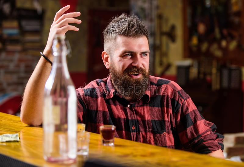 Bar relaxing place to have drink and relax. Man with beard spend leisure drinking strong alcohol. Drink for fun. Brutal stock photos