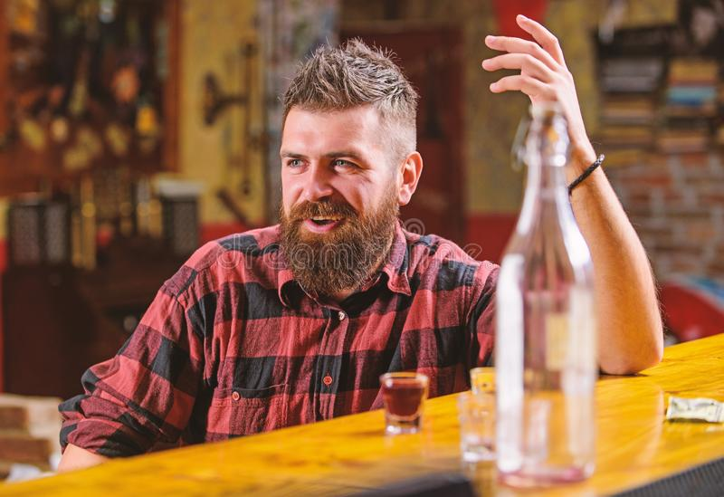 Bar relaxing place to have drink and relax. Man with beard spend leisure drinking strong alcohol. Drink for fun. Brutal royalty free stock photo