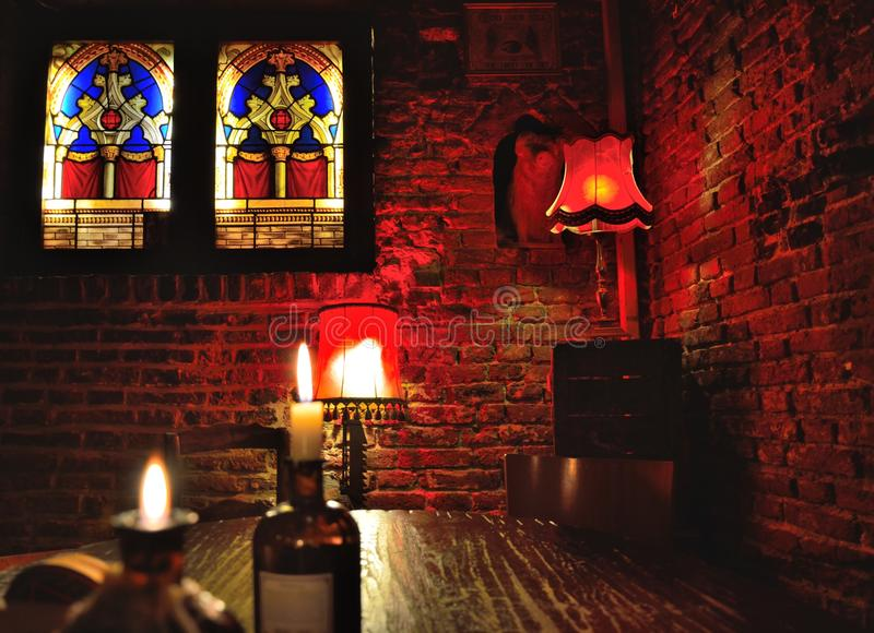 Bar scene, lustres in red and glass stained window. S at night royalty free stock images