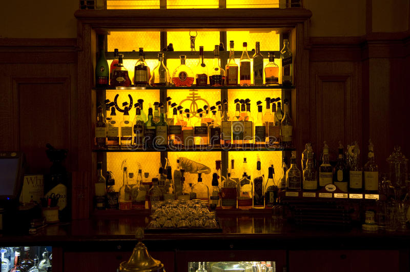 Bar shelves in vintage hotel stock photography