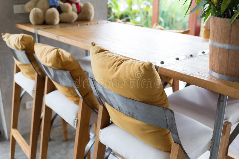 Bar stool and wooden table decorated in living room stock image