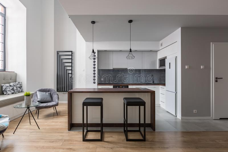 Bar stools and kitchen island stock image