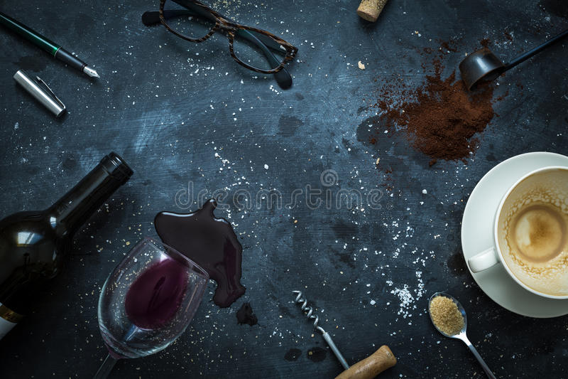 Bar table - empty coffee cup, wine, glasses and pen stock images
