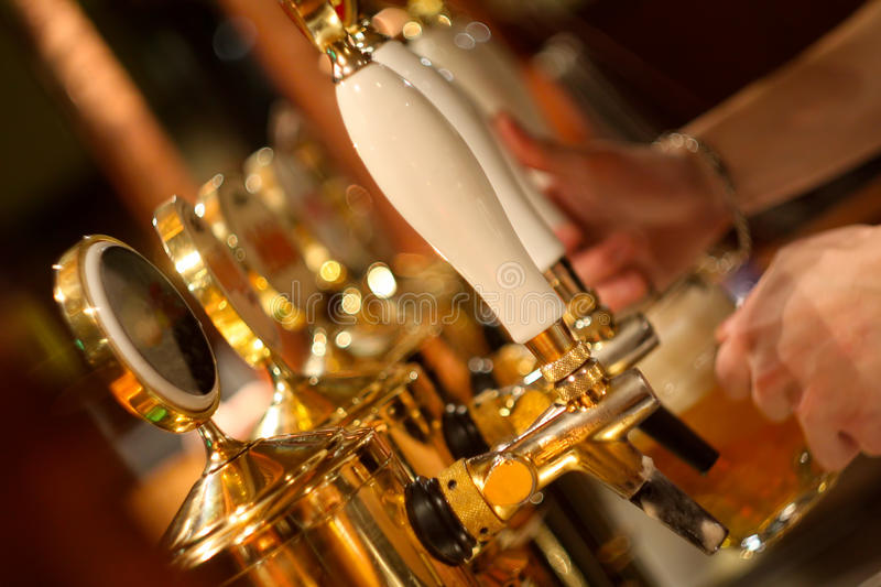 Bar tap of the beer stock image