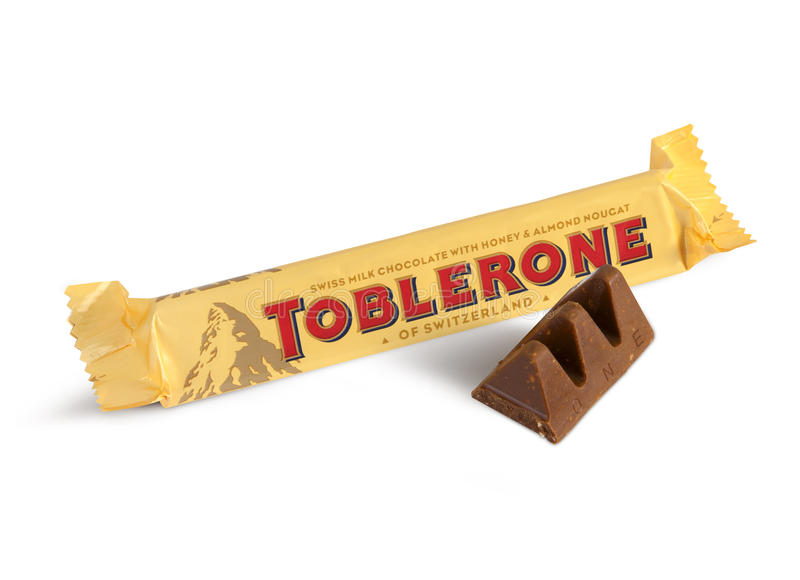 A bar of Toblerone. Chisinau, Moldova - June 14, 2016: A bar of Toblerone - Swiss milk chocolate with honey and almond nougat on a white background. With royalty free stock images