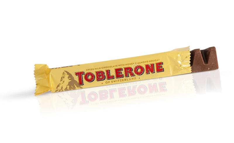 A bar of Toblerone. Chisinau, Moldova - June 14, 2016: A bar of Toblerone - Swiss milk chocolate with honey and almond nougat on a white background. With royalty free stock photo