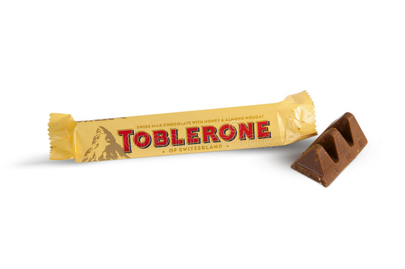Bar of Toblerone. Chisinau, Moldova - June 14, 2016: A bar of Toblerone - Swiss milk chocolate with honey and almond nougat on a white background. Open packing royalty free stock photo