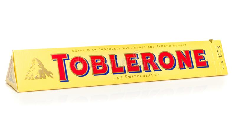 A bar of Toblerone milk chocolate. NIEDERSACHSEN, GERMANY OCTOBER 25, 2014: A bar of Toblerone milk chocolate on a white background stock images