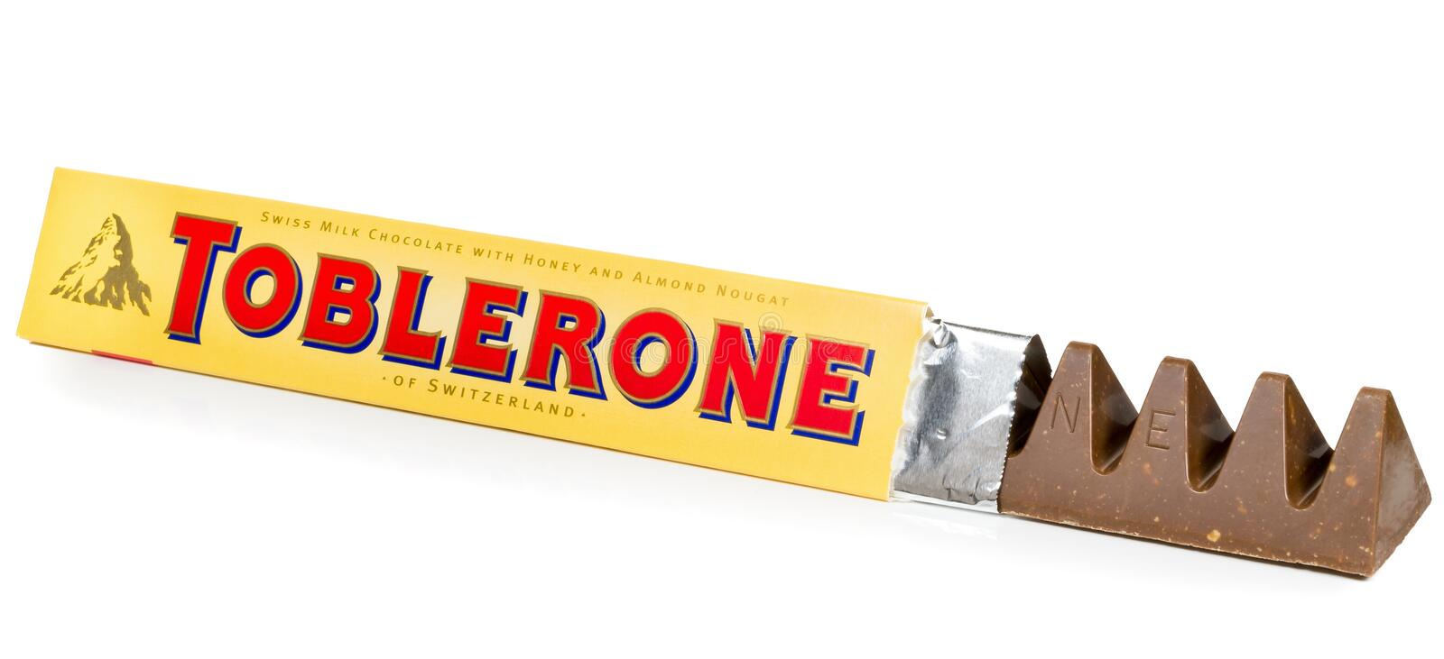 A bar of Toblerone milk cocolate. NIEDERSACHSEN, GERMANY OCTOBER 25, 2014: A bar of Toblerone milk chocolate on a white background royalty free stock photo