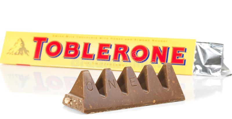 A bar of Toblerone milk cocolate. NIEDERSACHSEN, GERMANY OCTOBER 25, 2014: A bar of Toblerone milk cocolate on a white background stock photography