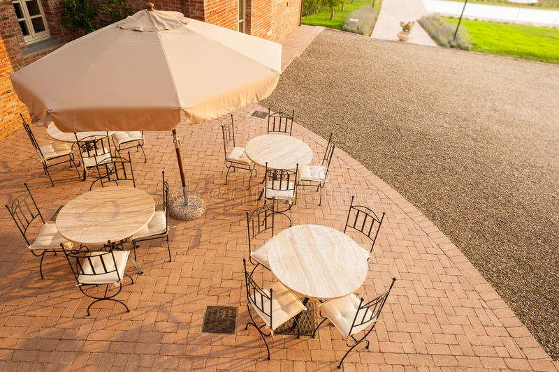 Bar in tuscany. A luxurious resort in tuscany with tables, umbrellas and chairs stock photos