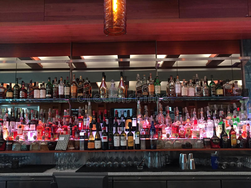 Bar with wide variety of drinks stock image